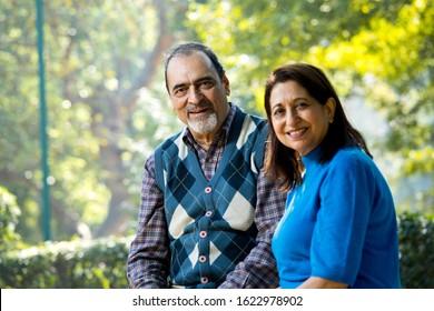 Portrait of senior couple smiling at park