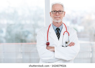 Portrait of senior doctor with arms crossed