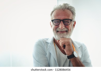 Portrait of senior doctor in examination room.