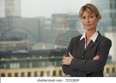 Portrait of a senior executive by a window looking at camera with space for copy