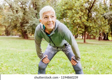Portrait Of Senior Fit Woman Ready For Running In Nature, Workout Outdoor.