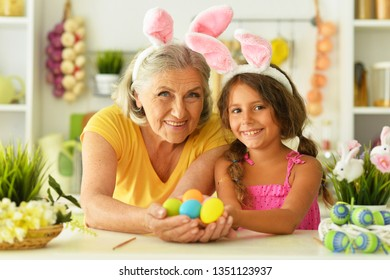 Portrait of senior grandmother and granddaughter with Easter eggs