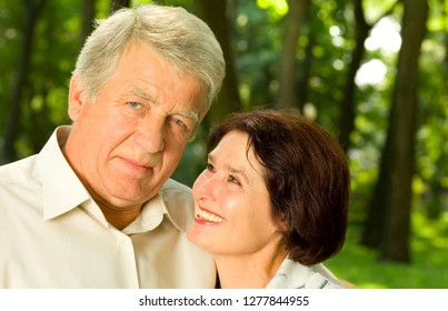 Portrait of senior happy smiling couple embracing, outdoor