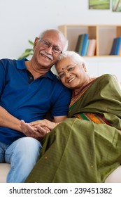 Portrait of senior Indian couple smiling and looking at the camera