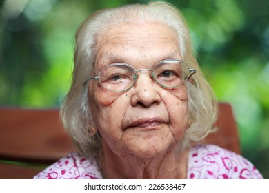 Portrait of a senior Indian woman in outdoor