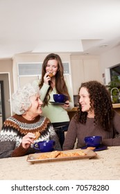 A portrait of a senior lady at home with her daughter and granddaughter