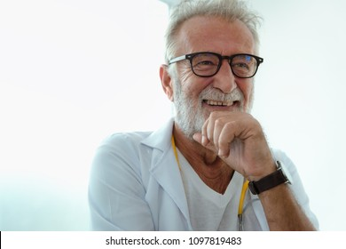Portrait of senior laughing doctor.