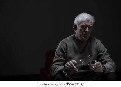 Portrait of senior man addicted to alcohol