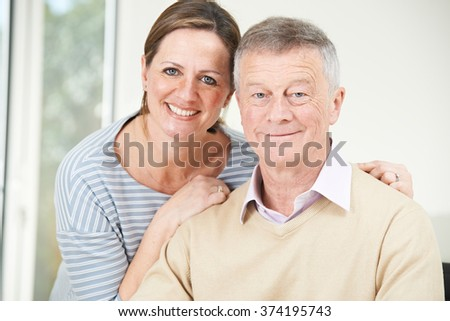 Portrait Of Senior Man With Adult Daughter