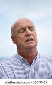 Portrait of a senior man annoyed