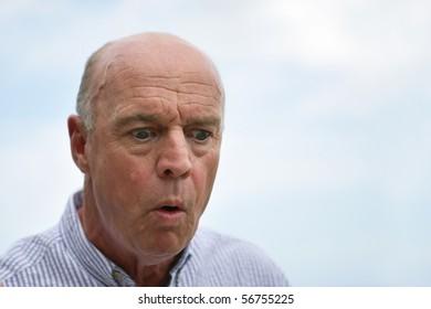 Portrait of a senior man astonished
