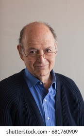 Portrait of a senior man in cardigan and glasses