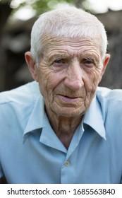 portrait of senior man close up outdoor