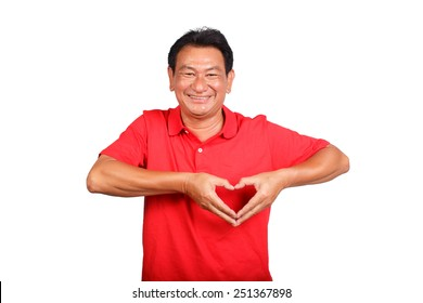 portrait of a senior man doing a heart gesture against a white background