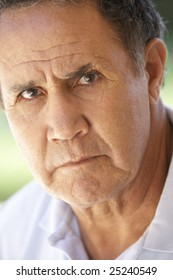 Portrait Of Senior Man Frowning At The Camera