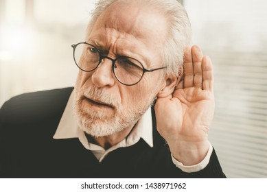 Portrait of senior man having hearing problems