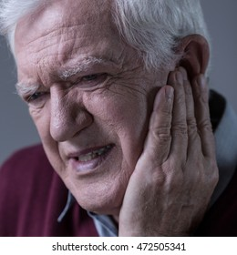 Portrait of senior man having terrible toothache
