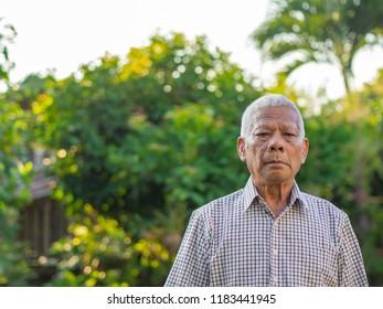 Portrait of senior man in his garden.