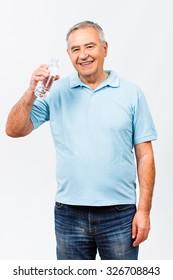 Portrait of senior man holding bottle of water.Healthy refreshment for senior man