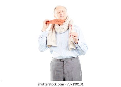 Portrait of senior man holding envelope with letter to Santa