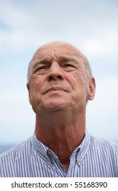 Portrait of a senior man looking away