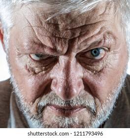 Portrait of a senior man looking skeptically