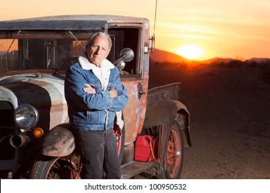Portrait of Senior Man Next to His Vintage Truck