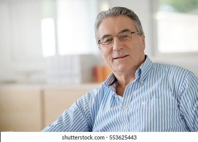 Portrait of senior man in office