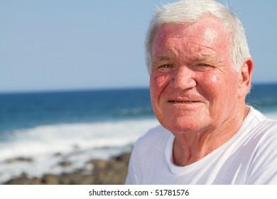 portrait of a senior man on beach