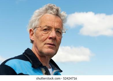 Portrait of a senior man outdoor whit blue sky