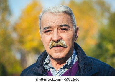Portrait of senior man in park.