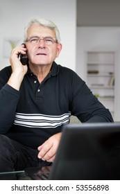 Portrait of a senior man phoning