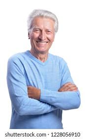 Portrait of senior man posing on white background