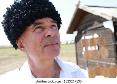 Portrait of senior man in Russian Karakul Kubanka Cossack Hat