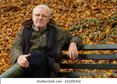 Portrait of a senior man sitting on the bench in park