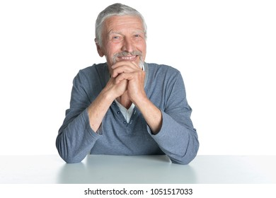 Portrait of   senior man sitting at table