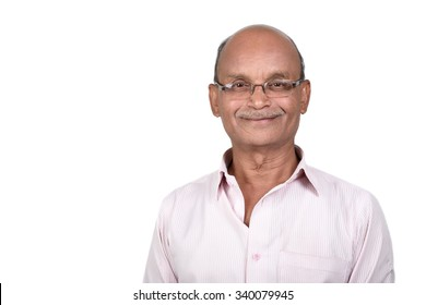 Portrait of a senior man smiling against white background. A senior Indian / Asian man - isolated on white