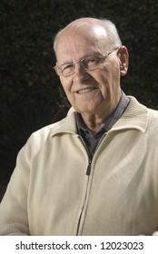 Portrait of a senior man standing in his garden