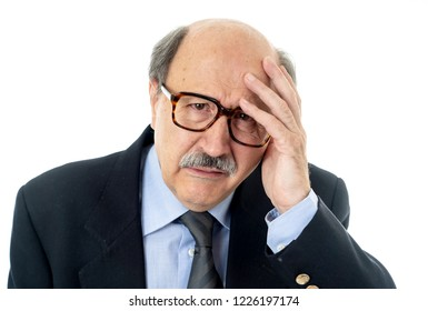 Portrait of senior mature old businessman looking sad and worried suffering pain and depression in sadness face expression Retirement and jobless concept isolated on neutral background.