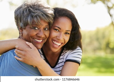 Portrait Of Senior Mother With Adult Daughter In Park
