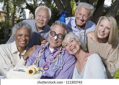 Portrait of senior people celebrating birthday
