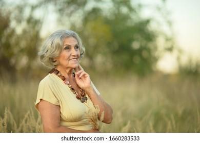 Portrait of a senior smiling woman in park