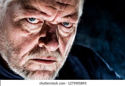 Portrait of a senior, stern looking man