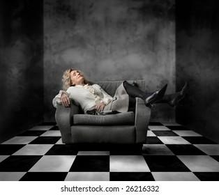 portrait of senior woman asleep on an armchair