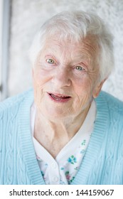 Portrait of a senior woman in a blue sweater outside