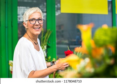 Portrait of senior woman buying on market