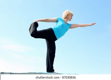 Portrait of a senior woman doing yoga outdoors