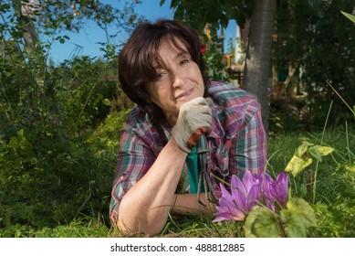 Portrait of senior woman during flowers planting