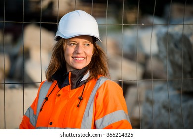 Portrait of senior woman engineer helmet wearing protective wear in work