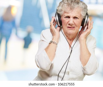 portrait of a senior woman listening to music indoor